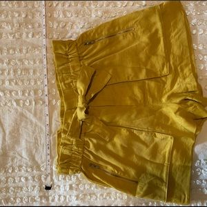 High waisted, tie shorts with zipper pocket detail